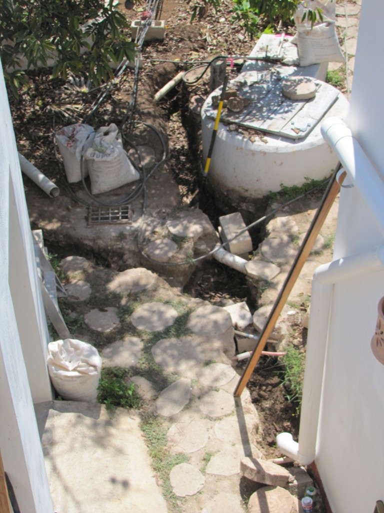 French drains. (Doing archeology near the well in our backyard.) What fun.