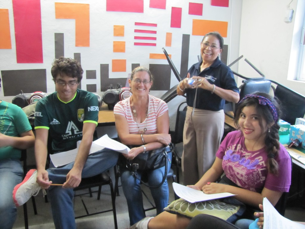 Maestra Silvia (standing) with students