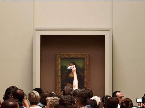 Photo credit © Ed Alcock / eyevine INTELLIGENT LIFE MAGAZINE MAY / JUNE 2014 Tourists flock to view the Mona Lisa painting by Leonardo da Vinci which hangs in the Louvre art gallery in Paris, France.