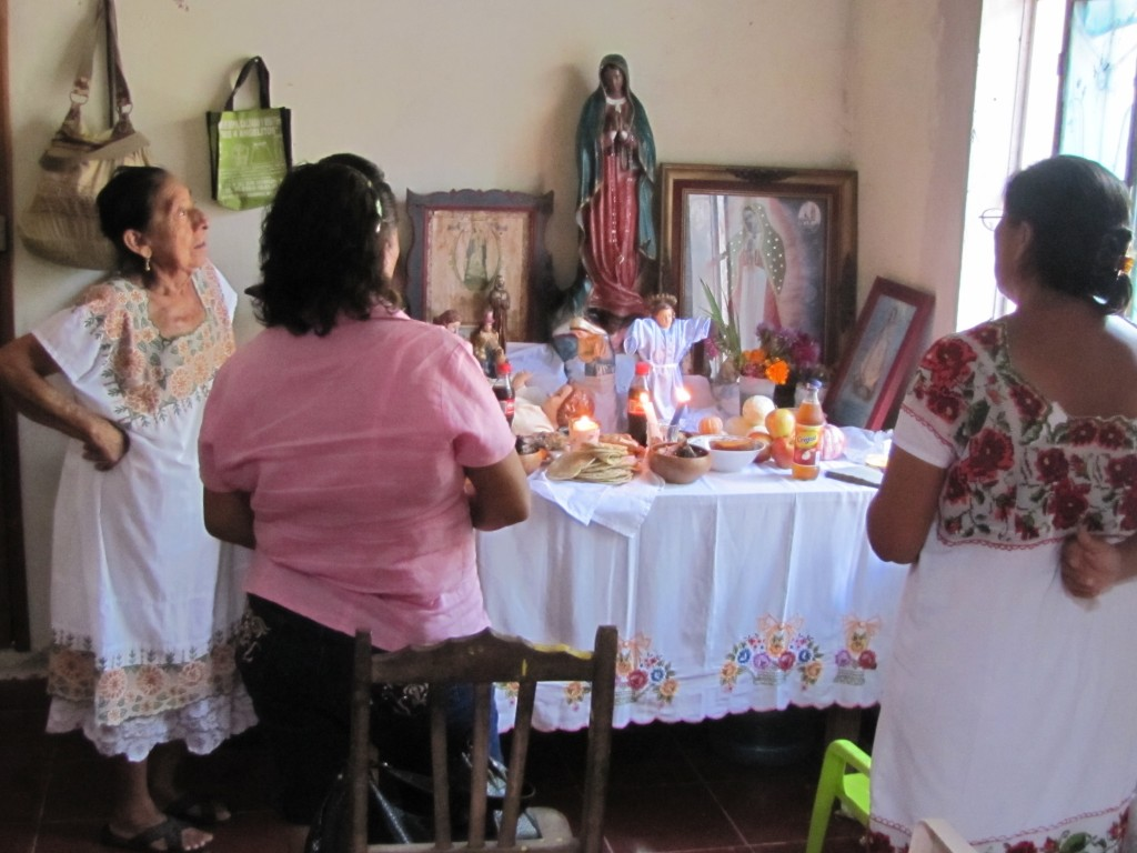 The altar, and prayers of thanksgiving inviting the ancestors to come and dine.