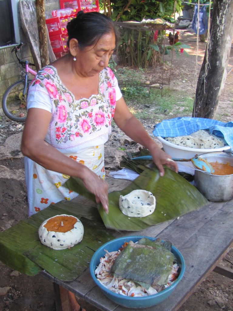 Juanita makes pibes, a corn and meat pie, for baking underground.